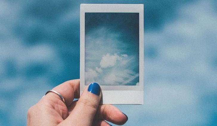 clouds-hand-pill-polaroid